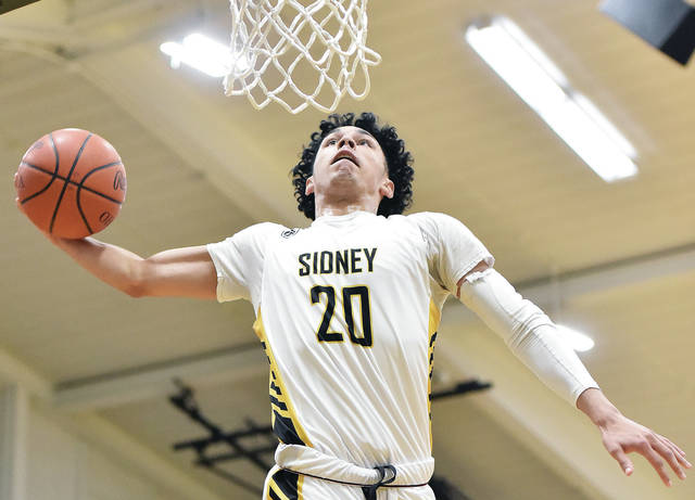 Sidney's Andre Gordon makes a one handed dunk during a nonconference game against Lehman Catholic on Feb. 4 in Sidney. Gordon was named first team all-Southwest district in Division I.