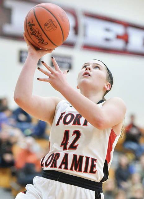 Fort Loramie junior forward Marissa Meiring goes for a layup during a nonconference game against Versailles on Dec. 22 in Fort Loramie. Meiring was named first team all-Southwest district in Division IV.