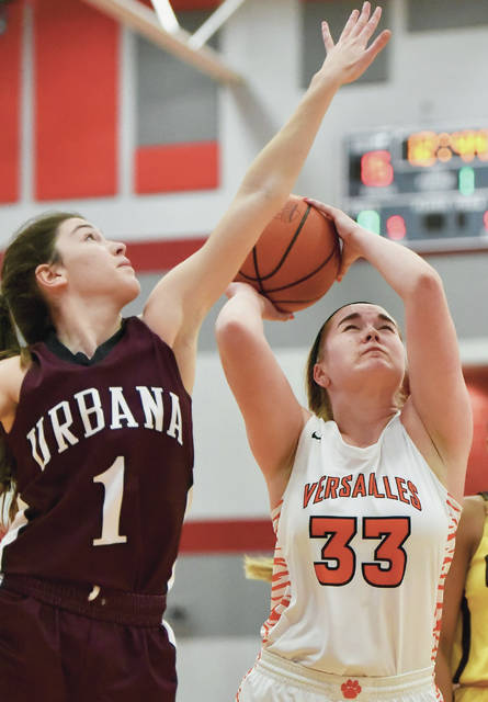 Versailles' Kelsey Custenborder shoots during the District Nine Div. I/II/III girls all-star game on Friday in Troy. Custenborder scored 13 points.