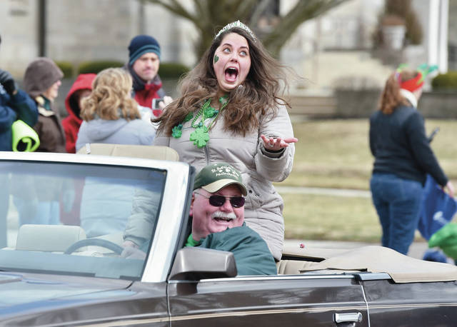 2019 McCartyville St. Patrick's Day Queen Erin Inman, of McCartyville, reacts as parade watchers throw candy at her during the annual McCartyville St. Patrick's Day Parade Saturday, March 16.
