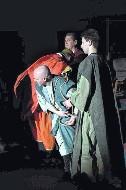 "Chris Beaver, portraying Apostle Peter, reacts during the rehearsal of ""The Message A.D."" Also pictured are, left to right, Nathan Graham, who is a soldier, Barry Zerkle, who is Jesus, and Spencer Hina, who is James."