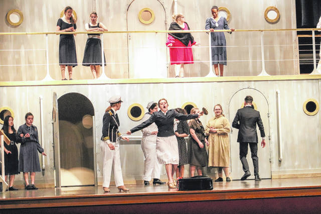 "The Purser, portrayed by Grace Hoellrich, center, tells the Captain, portrayed by Camryn Smith, left, that there aren't enough celebrities on their ship, the S.S. American, during a dress rehearsal Thursday night of ""Anything Goes"" at Sidney High School."