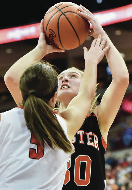 Minster's Courtney Prenger shoots with pressure from Cornerstone Christian's Madison Cloonan during a Division IV state semifinal on Friday at the Schottenstein Center in Columbus. Prenger led Minster with 18 points and nine rebounds