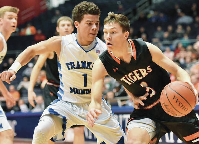 Jackson Center's Trent Platfoot drives against Franklin-Monroe during a Division IV district final on Friday at UD Arena. Platfoot scored 11 points.