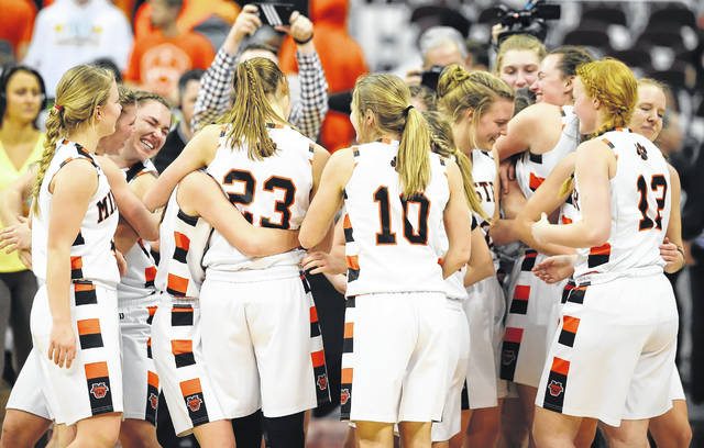 Minster players celebrate after beating Ottoville inthe Division IV state championship game on Saturday at Value City Arena in Columbus.