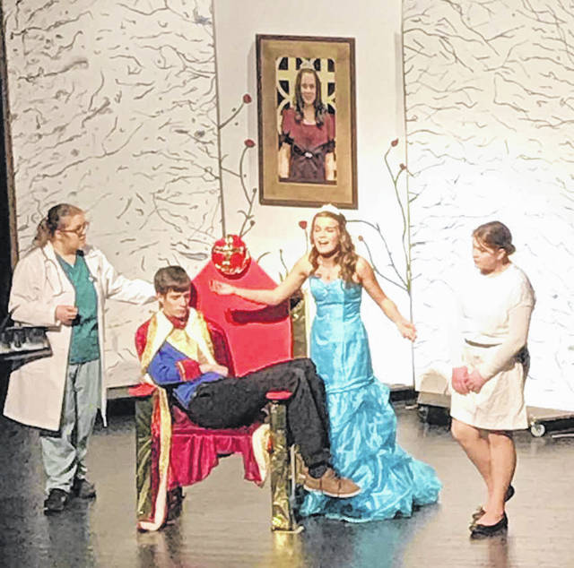 """From left to right, Dani Paulus, as Doctor Broccoli; Kaden Mescher, as King Ferdinand; Lydia Stricker, as Princess Philomena; and Alana Stricker, as Nursie, perform during a dress rehearsal of the play, """"Puss 'N Boots."""""""