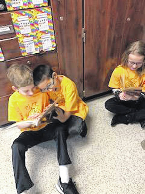 Russia fourth-grade students Logan Fullenkamp, Peter York and Allie Meyer are also members of the Russia Readers 100 Club.