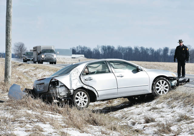 A car is pulled out of a field after it crashed into a utility pole on the 4000 block of state Route 705 shortly before 2 p.m. Wednesday, March 6. The top of the pole caught fire after the collision. The car was driving westbound on state Route 705 when it got too close to the edge and got caught in the gravel edge, causing the car to go down into the ditch and and strike the utility pole. No other vehicles were involved. No one was injured. The Fort Loramie Police responded to the scene.