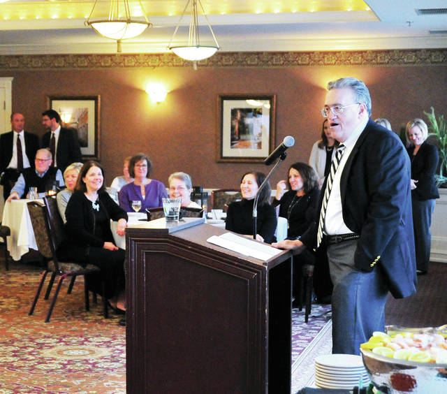 Sidney attorney Ralph Keister addresses the crowd at a joint Piqua/Sidney Chember of Commerce Business After Hours at the Piqua Country Club on Thursday.