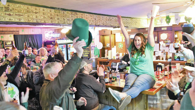 Erin Inman is introduced as the new incoming McCartyville St. Patrick's Day Queen at Patrickճ Pub in McCartysville.