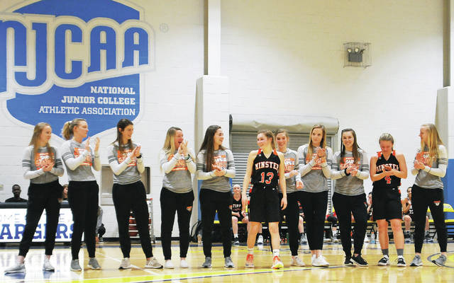 Minster's girls basketball team is recognized for winning the Division IV state championship during the between games in the 2019 Bill Moss Memorial Miami Valley Underclass Classic on Wednesday at Edison State Community College. Minster sophomore guards Janae Hoying and Ivy Wolf, both in black jerseys, participated in the game.