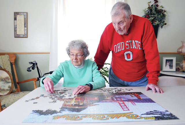 Phyllis, left, and Dick Zimpher, work on a puzzle at their Sidney house, Wednesday, March 27.