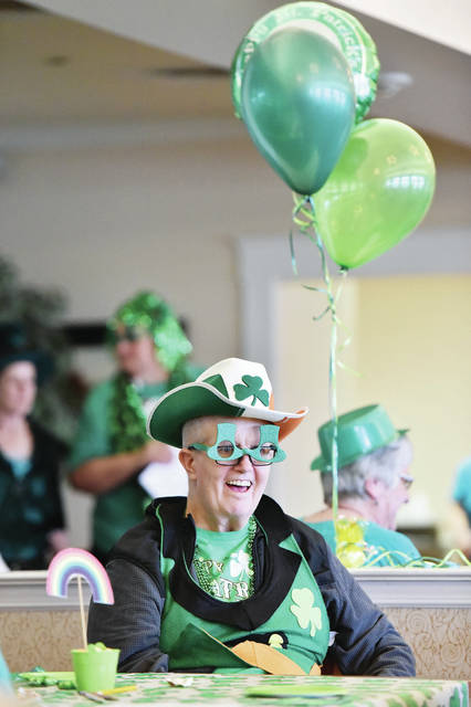 Chuck Lampy, of New Bremen, dressed in lots of green for a St. Patrick's Day Party at Elmwood Assisted Living Friday, Feb. 8. Residents listened to live music, played games and ate food.