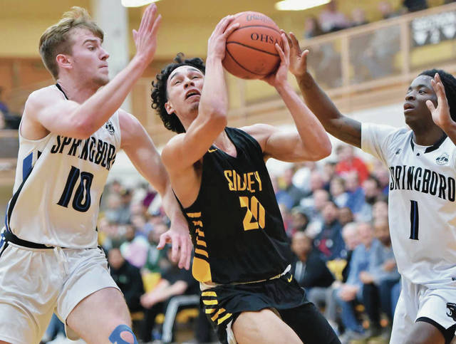 Sidney's Andre Gordon looks to shoot while covered by Springboro's Garrett Powell and Willieon Yates during a Division I sectional semifinal on Thursday in Vandalia. Gordon led Sidney with 45 points and scored 22 straight for the Yellow Jackets in the second half.