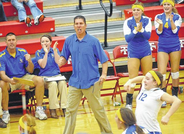 Lehman coach Greg Snipes reacts to a big point during a regional match at Tippecanoe High School in 2010, which is one of three years the Cavaliers won a state title during Snipes' tenure. Snipes, who is retiring from the school, won 492 matches in his tenure.