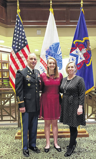 Lt. Col. Wayne Vornholt, left, a Sidney native and now of Leavenworth, Kan., his daughter, Chloe, and his wife, retired Army Lt. Col. Amanda Vornholt, pose for a family photo, recently, before Wayne retires from the Army, April 1.