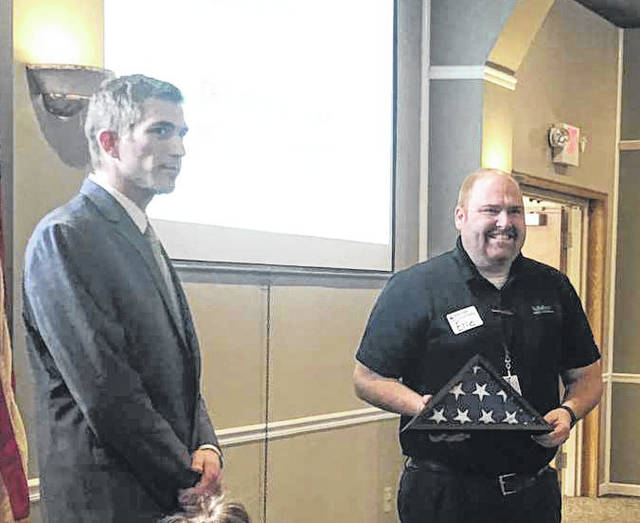 Eric Windeknecht, of Nidec Minster Corporation, was recognized during the annual Southwestern Auglaize County Chamber of Commerce awards lunch, on Tuesday, at Faith Alliance Church, in New Bremen. Windeknecht was presented a flag from the Architect of the Capitol, which was certifiably flown over the nation's Capitol in his honor.