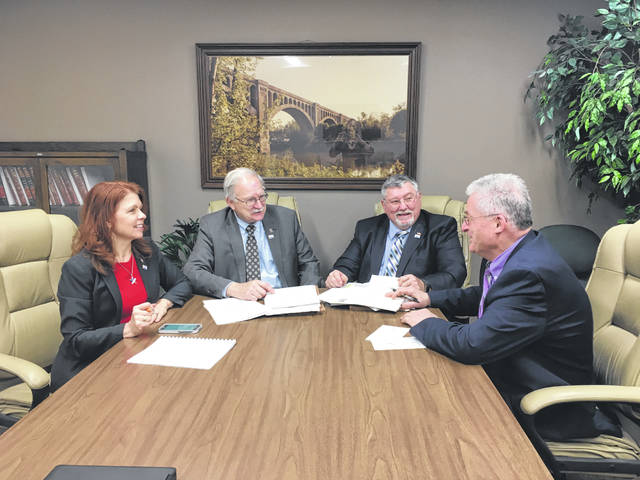 County Commissioners Julie Ehemann, Tony Bornhorst and Bob Guillozet meet with Shelby County Bicentennial Committee Chair Mike Barhorst to work out the final details of the opening ceremonies, scheduled for April 1 at 7 p.m. at Sidney Middle School.