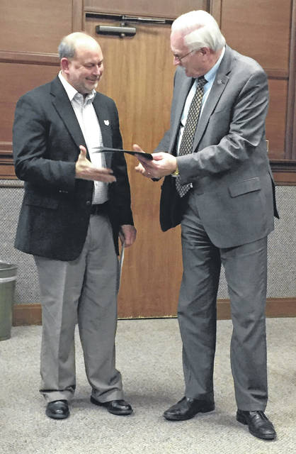 <p style=&quot;text-align: left;&quot;>Dave Proffitt, board member of the Northern Miami Valley Ohio Chapter of the American Red Cross, receives a proclamation naming March 2019 to be American Red Cross Month in the city of Sidney from Mayor Mike Barhorst. The proclamation was presented Monday evening during Sidney City Council&#8217;s workshop session.
