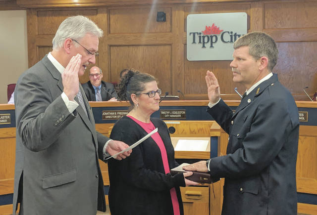 Tipp City's new Fire and EMS chief, Cameron Haller, was sworn in Monday night by Mayor Joe Gibson.