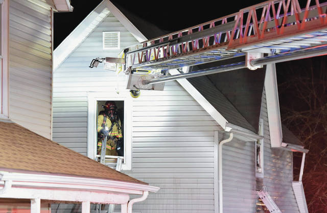 Sidney firefighters finish knocking out a house fire at 106 N. Pomeroy Ave. that started shortly before 10 p.m. Tuesday, March 26.