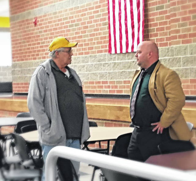 Concerned citizen Jim Piatt, left, and Assistant Shelby County Prosecutor Aaron Lowe discuss the topic of bullying after Thursday's presentation.