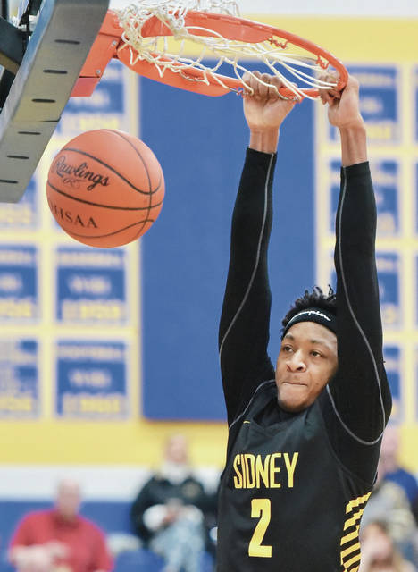 Sidney senior forward Ratez Roberts dunks during a nonconference game on Feb. 2 in St. Marys. Roberts is one of 23 area players that will play in District Nine all-star games on Thursday and Friday in Troy.