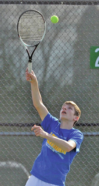 Lehman Catholic's Sam Gilardi serves at second singles during a match on Wednesday at Troy.