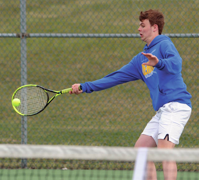 Lehman Catholic's Danny Lins hits a forehand during a match against Piqua on Thursday in Sidney. Lins won 6-1, 6-1 at first singles.