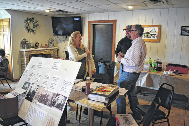 Travel agent Julie Poeppelman Kimmel discusses plans for the trip to Germany in September. She is a great-great-granddaughter of immigrants Heinrich and Catherina Poeppelman.