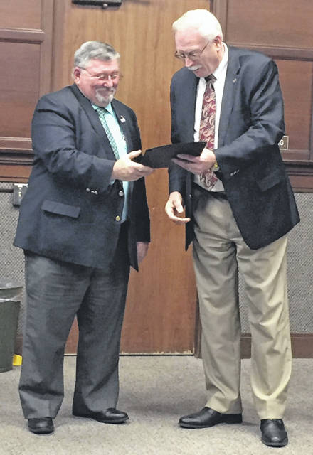 Shelby County Commissioner Bob Guillozet, left, receives a proclamation of April 1, 2019, to be Shelby County Bicentennial Day in Sidney from Mayor Mike Barhorst during Tuesday's City Council meeting. The proclamation is in recognition of Shelby County's 200th birthday.