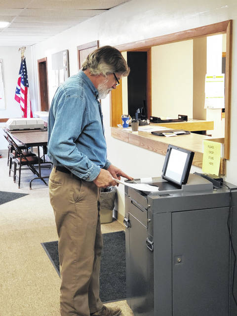 Christopher Gibbs, of Maplewood, was the first person to cast an absentee ballot Tuesday morning at the Shelby County Board of Elections.