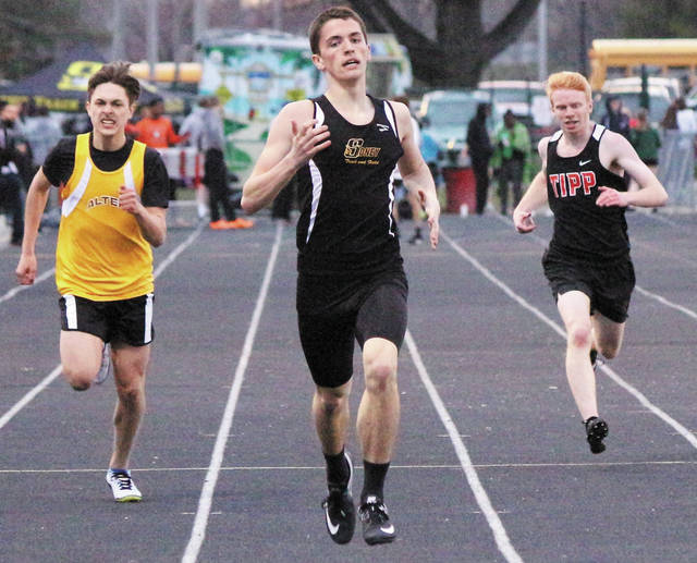 Sidney sophomore Curtis Spangler runs during the 400 meter dash during the Herb Hartman Invitational on Friday at Troy Memorial Stadium.