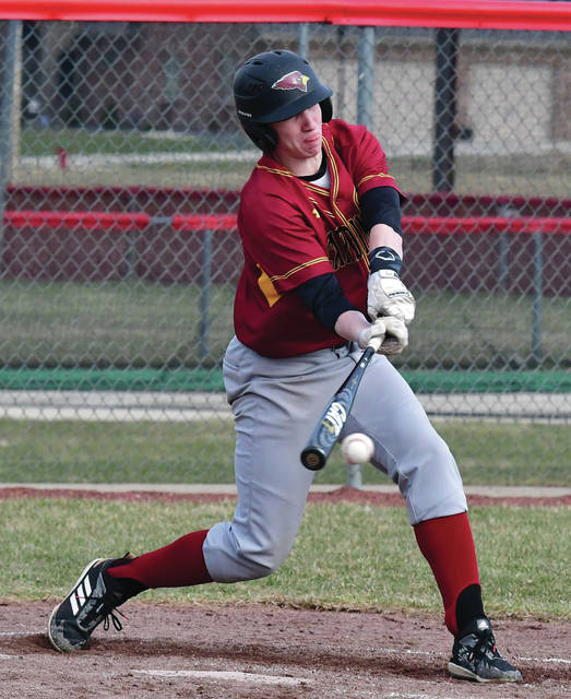 New Bremen's Ryan Bertke hits during a nonconference game on Tuesday in New Bremen.
