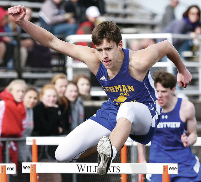 Lehman Catholic's Brendan O'Leary runs the 110 meter hurdles during the Minster Invitational on Saturday in Minster. O'Leary finished first in the 300 hurdles in 44.23.