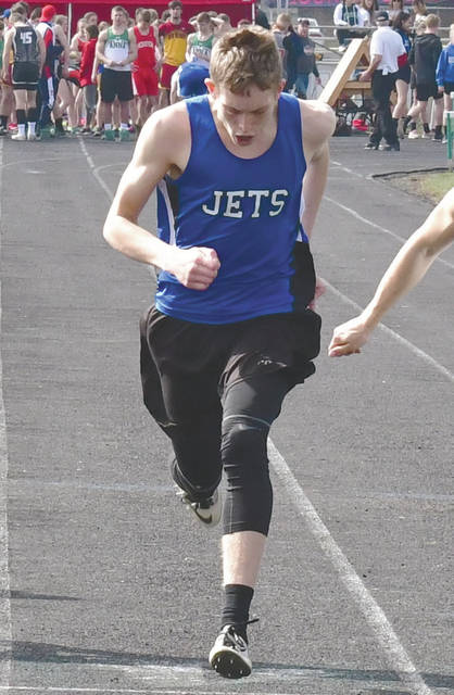 Fairlawn's Jackson Jones competes in the 100 meter run during the Anna Invitational on Saturday. Jones won in 11.24.