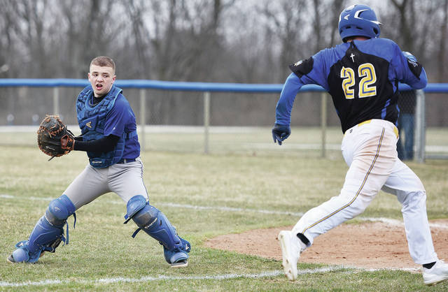Fairlawn's Drew Maddy turns around with the ball as Lehman Catholic's Bryce Kennedy heads for home during a nonconference game on Thursday in Sidney.