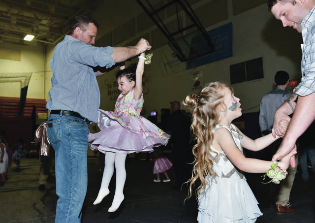 John Cline, left to right, dances with his granddaughter Paisley Cline, 3, both of Sidney, daughter of Paige Cline, during the Gateway Arts Council's Princess Ball at Lehman Catholic High School Friday, April 26. Also dancing are Braylee Cline, 5, and her dad, Jake Cline, both of Bradford. Braylee is also the daughter of Ashlee Cline.