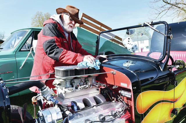 Herb VanTilburgh, of Sidney, cleans off his 1930 Plymouth Roadster Hotrod for a car show at the Shelby County Bicentennial event celebrating the declaration of Hardin as the first county seat Saturday, April 27.
