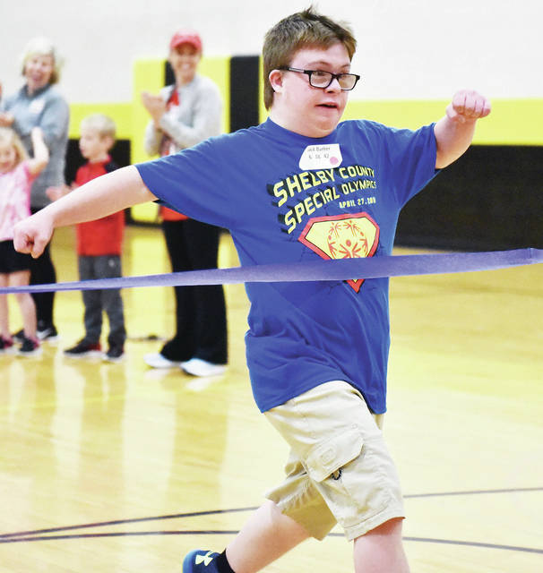 Jack Barker, 15, of Sidney, son of Jayson and Wendy Barker, runs the 50 meter dash during the Shelby County Special Olympics held at the Sidney Middle School Saturday, April 27.