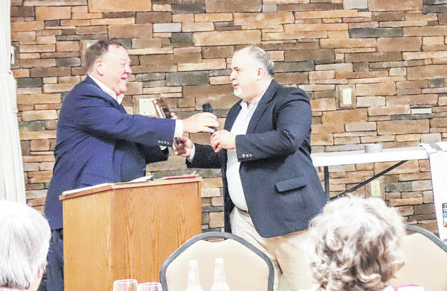 Shelby County Democratic Chairman Tom Kerrigan, left, congratulates Mark Mabelitinim, who was chosen as the Democrat of the Year.