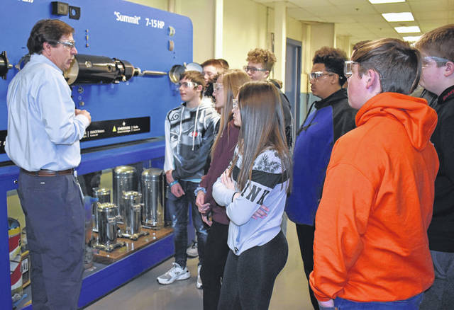 Tim Williams, quality assurance manager at Emerson, talks to a group of Sidney High School freshman about how a compressor works, recently. The students toured the manufacturing plant during an Emerson We Love STEM program in conjunction with the Workforce Partners of Shelby County. Sixty students visited several companies.