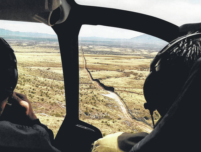"Fencing along the Arizona-Mexico border is pictured from inside a helicopter in which Shelby County Sheriff John Lenhart and Shelby County Commissioner Julie Ehemann were touring during the first week of April. Lenhart and Ehemann traveled to the Cochise County, Arizona border to attend the outreach program, ""From Our Borders to Yours: Ground Zero."""