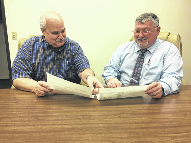Sidney volunteer levy committee members John Coffield, left, and Chair Bob Guillozet look over the paperwork for the city's 0.30 percent levy that will be on the May ballot. Coffield is serving as treasurer for the levy committee.