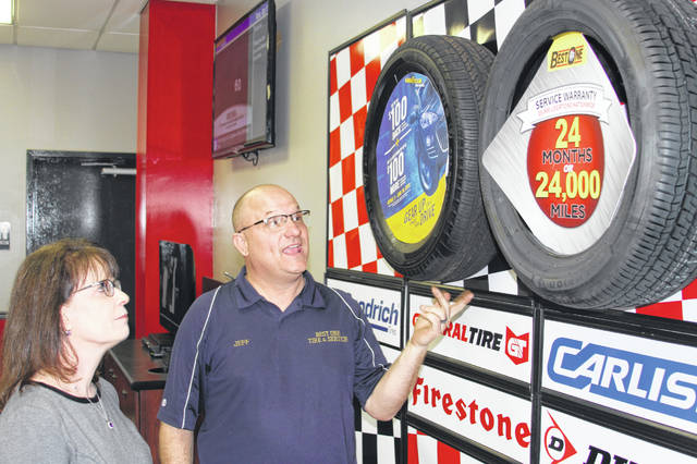 Jeff Pollard, co-owner/operator of Best One Tire at 120 N. Stolle Ave. in Sidney, shares information on some of the tires he sells with State Supreme Court Justice Judith L. French who visited his business to learn more about the needs of business owners in Ohio. She visited Sidney Monday afternoon, April 1.