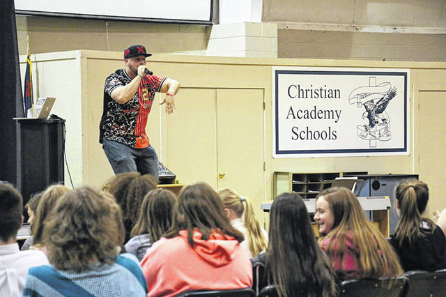 Rapper J-Nibb performs for students at Christian Academy Schools recently. He encouraged students to follow their passions.