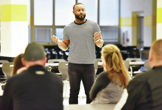 Sidney girls basketball coach Jamal Foster talks to parents during a team meeting on Wednesday at the high school cafeteria. Foster, a Sidney alum, was approved by the school's board of education to take over the program last week.