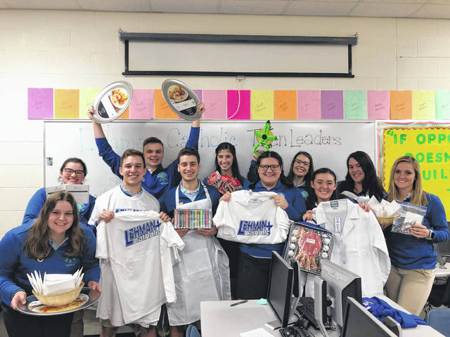 The Lehman Catholic High School Teen Leadership Corps collected school supplies for high school students of St. John's Academy in Portsmouth, Commonwealth of Dominica. The Lehman students now are collecting gently used instruments and supplies.