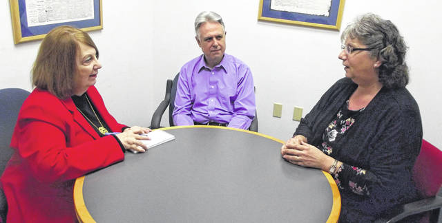Patricia Ann Speelman, left, Localife and Business editor of the Sidney Daily News, interviews Peter and Sandy Huelsebusch at the newspaper office recently for an upcoming story. Speelman will retire at the end of April.