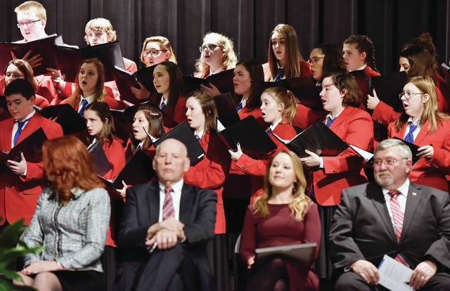 The Shelby County Bicentennial Choir performs Beautiful Ohio during the Shelby County Bicentennial opening celebration Monday, April 1, at Sidney Middle School.